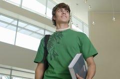Estudiante joven With Book Fotos de archivo libres de regalías