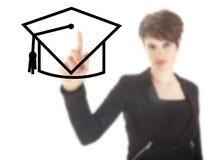 Estudiante joven con el sombrero negro aislado Imagen de archivo libre de regalías