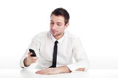 Estudiante joven con el teléfono móvil Imagen de archivo