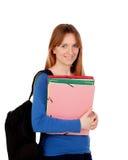 Estudiante joven con la mochila y los libros Imágenes de archivo libres de regalías