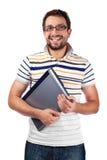 Estudiante joven con la sonrisa de la computadora portátil Imágenes de archivo libres de regalías