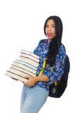 Estudiante joven con los libros en blanco Foto de archivo libre de regalías