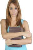 Estudiante joven con un libro a disposición Fotos de archivo libres de regalías