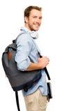 Estudiante joven confiado de nuevo a escuela en el fondo blanco Foto de archivo libre de regalías