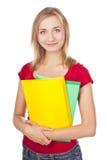 Estudiante joven en un estudio con los libros de textos Imagen de archivo libre de regalías