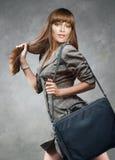 Estudiante joven hermoso con el bolso Fotografía de archivo libre de regalías