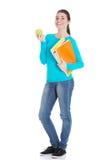 Estudiante joven hermoso con los ficheros y la manzana. Foto de archivo