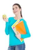 Estudiante joven hermoso con los ficheros y la manzana. Fotos de archivo