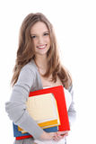Estudiante joven hermoso sonriente con los libros Imagen de archivo libre de regalías
