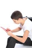 Estudiante joven que hace la preparación Fotos de archivo libres de regalías