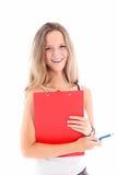 Estudiante joven sonriente con el sujetapapeles Fotografía de archivo libre de regalías