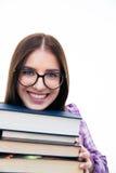 Estudiante joven sonriente con los libros Fotos de archivo libres de regalías