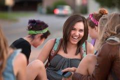 Estudiante lindo que ríe con los amigos Imágenes de archivo libres de regalías