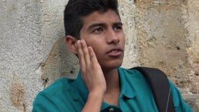 Estudiante masculino adolescente confuso Foto de archivo