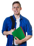 Estudiante masculino caucásico de risa con el pelo rubio Fotos de archivo libres de regalías