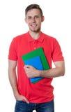 Estudiante masculino caucásico de risa con la camisa roja y el pelo rubio Imagenes de archivo