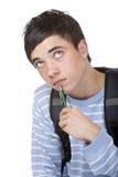 Estudiante masculino contemplativo joven que se sienta en suelo Imágenes de archivo libres de regalías