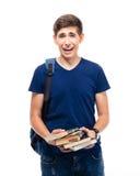 Estudiante masculino de risa que sostiene los libros Imagen de archivo