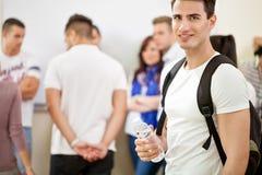 Estudiante masculino en la universidad Imágenes de archivo libres de regalías