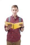 Estudiante masculino feliz que sonríe - aislado sobre un fondo blanco Fotografía de archivo