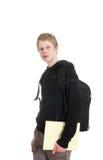 Estudiante masculino que sostiene algunos cuadernos Fotos de archivo libres de regalías