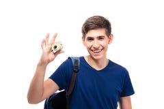Estudiante masculino que sostiene el dinero Foto de archivo libre de regalías