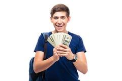 Estudiante masculino que sostiene el dinero Foto de archivo