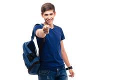 Estudiante masculino sonriente que señala en la cámara Fotos de archivo