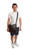 Estudiante ocasional que se coloca con el bolso Foto de archivo