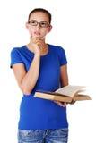 Estudiante pensativo que mira para arriba Fotos de archivo