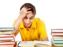 Estudiante preocupado con los libros Fotos de archivo