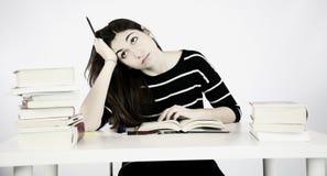 Estudiante preocupante triste con los libros Fotografía de archivo