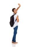 Estudiante que agita adiós imagen de archivo libre de regalías