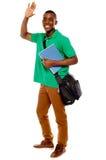 Estudiante que agita sus manos. Goce Imagen de archivo libre de regalías