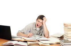 Estudiante que bosteza Imagenes de archivo