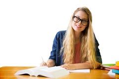 Estudiante que estudia en la biblioteca Fotos de archivo