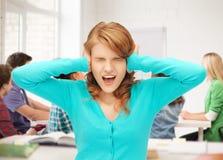 Estudiante que grita en la escuela Imagenes de archivo