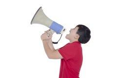 Estudiante que grita a través del megáfono Fotografía de archivo libre de regalías