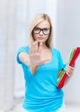 Estudiante que hace gesto de la parada Foto de archivo libre de regalías