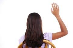 Estudiante que levanta la mano Imágenes de archivo libres de regalías
