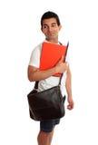 Estudiante que mira sobre hombro Foto de archivo libre de regalías