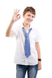 Estudiante que muestra gesto aceptable Imagenes de archivo