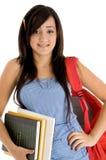 Estudiante que presenta con el bolso y los libros Fotografía de archivo