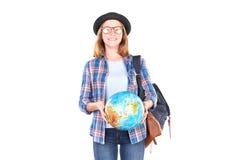 Estudiante que presenta con el globo Imágenes de archivo libres de regalías