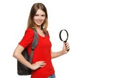 Estudiante que se coloca con la lupa, Imagen de archivo libre de regalías