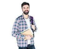 Estudiante que sostiene cuadernos aislados en blanco con el espacio de la copia Fotografía de archivo