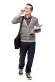 Estudiante que usa el teléfono móvil Imágenes de archivo libres de regalías