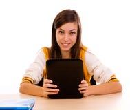 Estudiante que usa un ordenador de la tablilla Imagenes de archivo