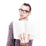 Estudiante serio con el libro Foto de archivo