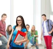 Estudiante sonriente con el bolso, las carpetas y PC de la tableta Fotografía de archivo libre de regalías